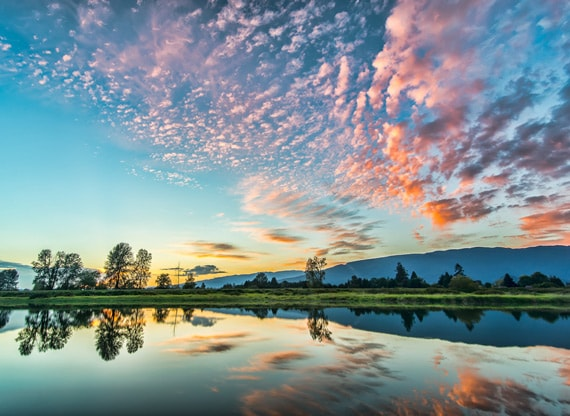 «Великолепные облака на закате солнца» Фотограф James Wheeler
